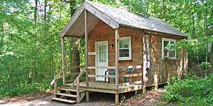 large rustic cabin at pinch pond family campground